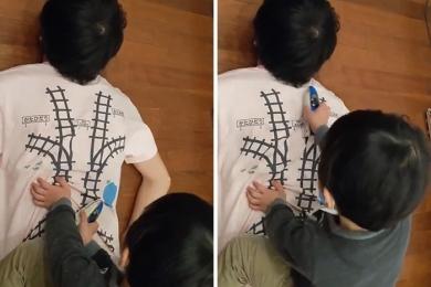 Pai cria camiseta que faz seu filho lhe dar uma massagem